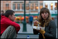 Young woman eating fries, Markt. Bruges, Belgium ( color)