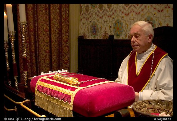 Priest and relic of Christ's blood. Bruges, Belgium (color)