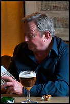 Man with book and beer. Brussels, Belgium (color)