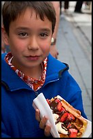 Boy eating a Belgian waffle. Brussels, Belgium (color)