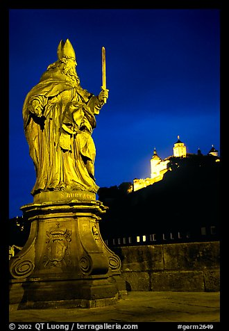 Saint Killian statue on  Alte Mainbrucke (bridge) and Festung Marienberg (citadel) at night. Wurzburg, Bavaria, Germany (color)