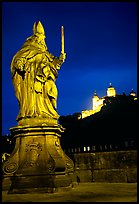 Saint Killian statue on  Alte Mainbrucke (bridge) and Festung Marienberg (citadel) at night. Wurzburg, Bavaria, Germany