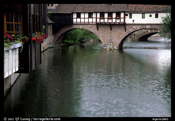 Timbered houses built accross the river. Nurnberg, Bavaria, Germany (color)