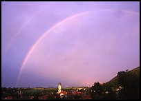 Rainbow over Nesselwang and St Andreas church. Bavaria, Germany (color)