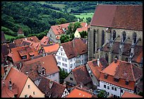 House rooftops and Kirche Sankt-Jakob seen from the Rathaus tower. Rothenburg ob der Tauber, Bavaria, Germany (color)