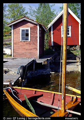 Boat and cabins. Gotaland, Sweden (color)