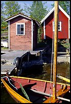 Boat and cabins. Gotaland, Sweden