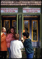 Swedish kids in a phone booth. Stockholm, Sweden ( color)