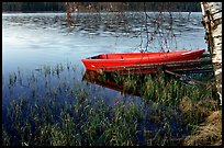 Red boat on a lakeshore. Central Sweden