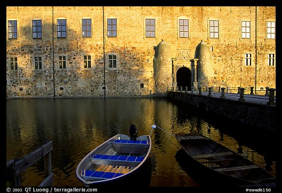Boat and moat of Vadstena slott. Gotaland, Sweden