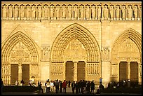 People standing in front of gates of Notre Dame Cathedral, late afternoon. Paris, France (color)