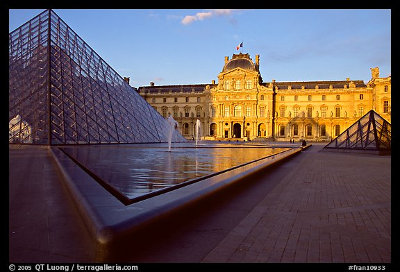 Pyramid, basins, and Sully Wing  in the Louvre, sunset. Paris, France (color)