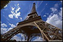 Wide view of Eiffel tower from its base. Paris, France