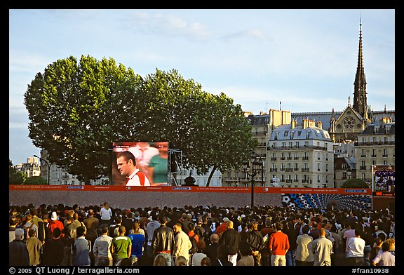 Crowds watch a broadcast of a soccer match near Hotel de Ville. Paris, France (color)