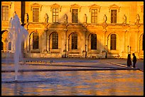 Basin and projected shadow of the Pei pyramid on the Louvre at sunset. Paris, France