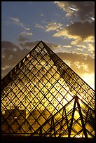 Louvre pyramid transparent at sunset. Paris, France