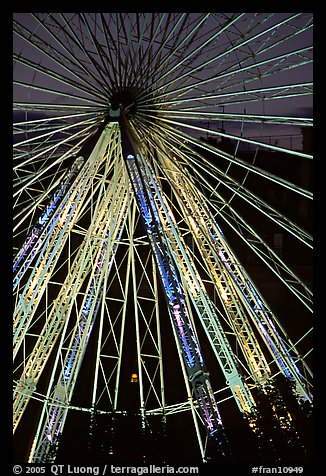 Lighted Ferris wheel in the Tuileries garden. Paris, France (color)