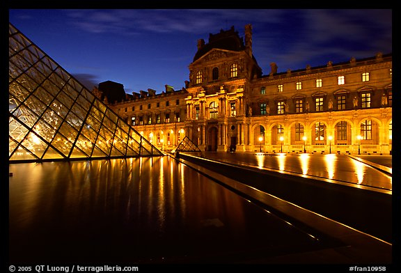 Basin, Pyramid, and Louvre at dusk. Paris, France