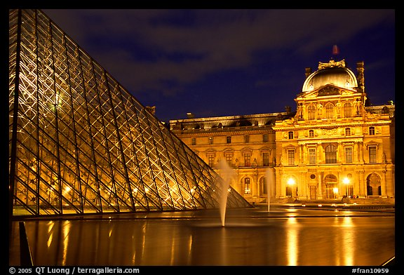 Pyramid, basin, and Louvre at night. Paris, France (color)
