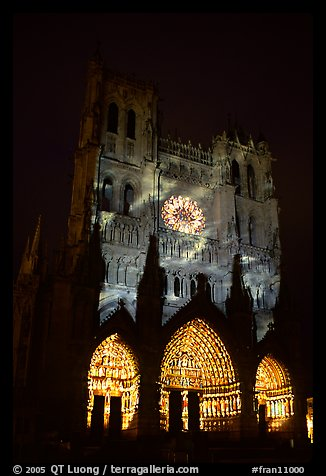 Cathedral facade illuminated at night, Amiens. France