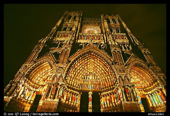 Looking up Notre Dame Cathedral laser-illuminated to recreate original colors, Amiens. France