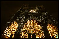 Looking up cathedral with doors laser-illuminated to recreate original colors, Amiens. France