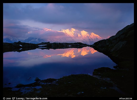 Mont Blanc range reflected in pond at sunset, Chamonix. France (color)
