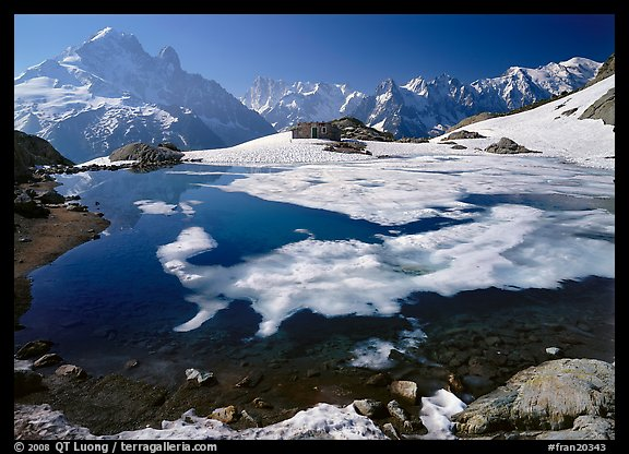 Partly Frozen Lac Blanc, Aiguille Verte, and Mont-Blanc range, Chamonix. France (color)