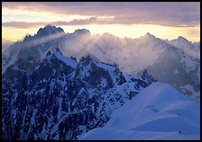 Sunrays over Chamonix Aiguilles, Aiguille Verte, Droites, and Courtes, Chamonix. France ( color)