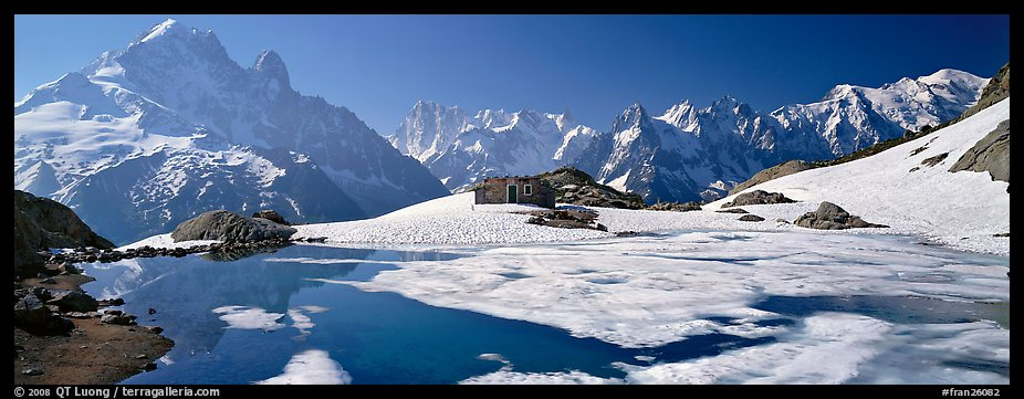 High mountain landscape with partly frozen lake and Mont-Blanc Range. France (color)