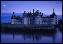 Chambord chateau at dusk with moonrise. Loire Valley, France (color)