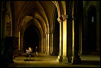 Worshiper inside the Saint-Etienne Cathedral. Bourges, Berry, France ( color)