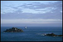 Islets and lighthouse on the coast. Brittany, France (color)