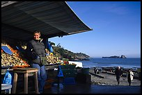 Oyster stand and vendor in Cancale. Cancale oysters are reknown in France. Brittany, France (color)