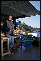 Oyster stand and vendor in Cancale. Brittany, France ( color)