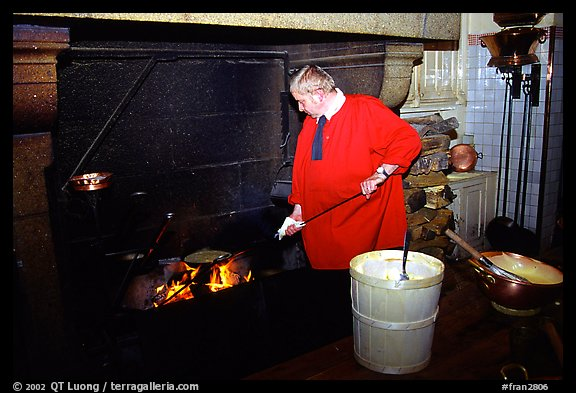 Baking the famous Omelette de la mere Poularde at the eponymous restaurant. Mont Saint-Michel, Brittany, France (color)
