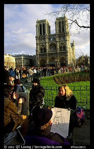 Sketch drawers in front of Notre Dame Cathedral. Paris, France