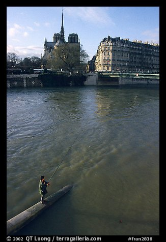Fishing in the Seine river, Notre Dame Cathedral in the background. Paris, France (color)