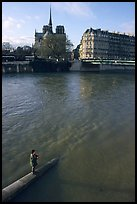 Fishing in the Seine river, Notre Dame Cathedral in the background. Paris, France