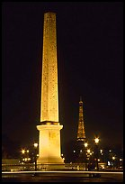 Luxor obelisk of the Concorde plaza and Eiffel Tower at night. Paris, France