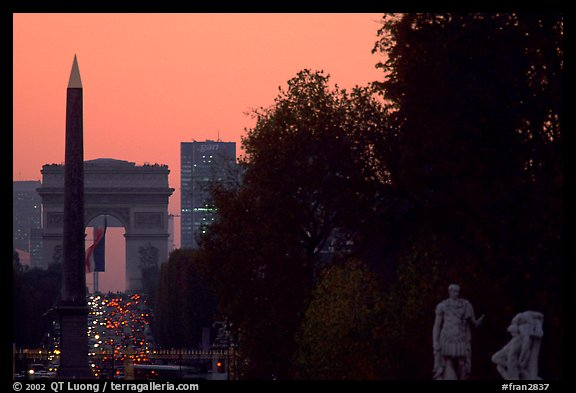 Obelisk of the Concorde and Arc de Triomphe at sunset. Paris, France (color)