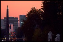Obelisk of the Concorde and Arc de Triomphe at sunset. Paris, France