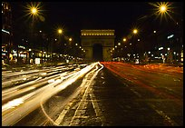 Arc de Triomphe seen from the middle of Champs Elysees at night. Paris, France (color)