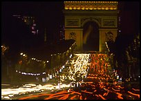 Arc de Triomphe and Champs Elysees at night with car light trails. Paris, France