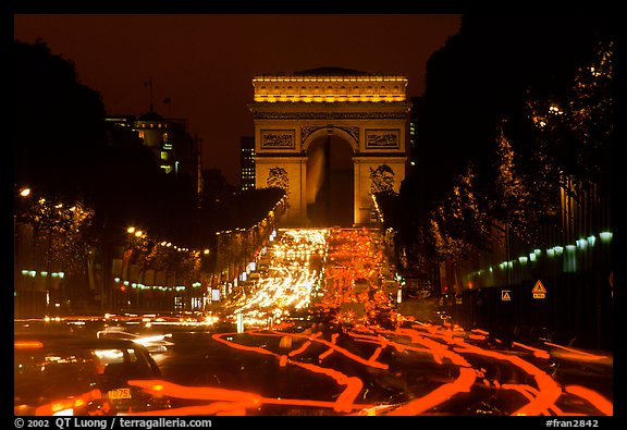 Arc de Triomphe and Champs Elysees at night. Paris, France