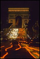 Arc de Triomphe and lights of cars on Champs Elysees. Paris, France (color)