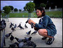 Girl feeding pigeon, Jardin du Luxembourg. Quartier Latin, Paris, France
