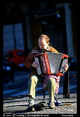 Accordeon player on the street. Paris, France (color)