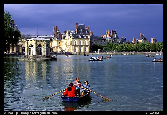 Rowers and Fontainebleau palace. France (color)