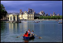 Rowers and Fontainebleau palace. France